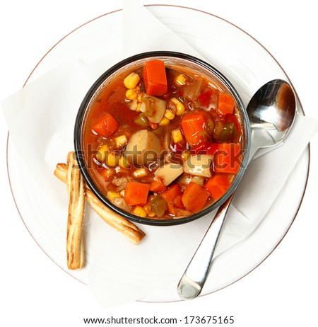 Chunky Maryland Style Crab Stew with bread sticks in bowl over white. - stock photo