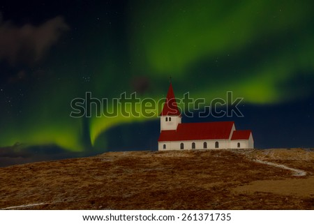 Church and Aurora Borealis in Vik, Iceland, taken in moonlight