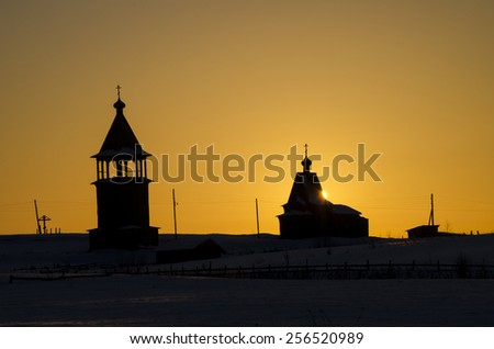 Church and bell tower at sunset (Russia, Arkhangelsk region)