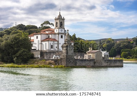 Church and cemetery of Los Dolores in Niembro bay, Asturias, Spain - stock photo