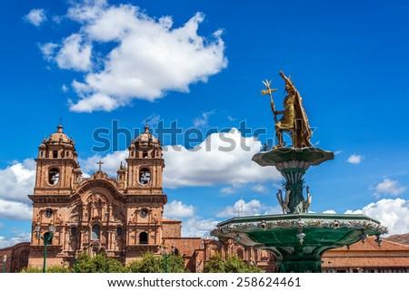 Church and Incan fountain in the Plaza de Armas of Cusco, Peru - stock photo