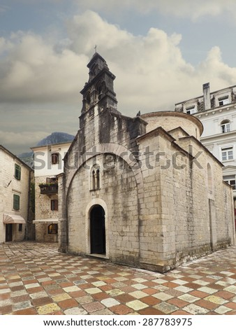 Church and Multi-Colored Stone Street of Kotor, Montenegro After the Rain  - stock photo