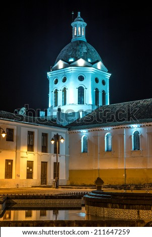 Church and steeple at night time, Cuenca, Ecuador - stock photo