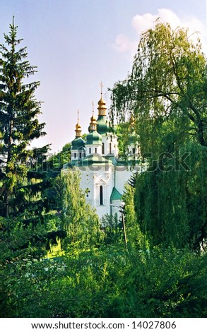 Church and the green trees. - stock photo