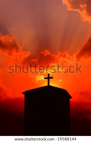 Church at dusk with religious cross - stock photo