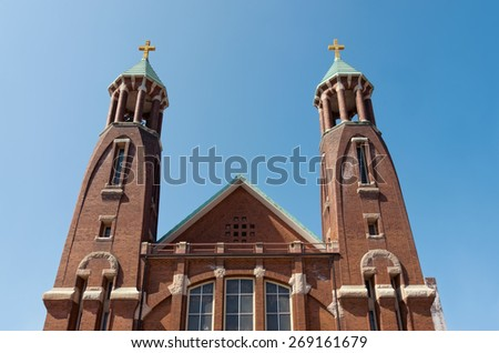 church bell towers and spires in saint paul of art nouveau architecture style against blue sky - stock photo