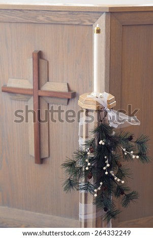 Church candle and cross - stock photo