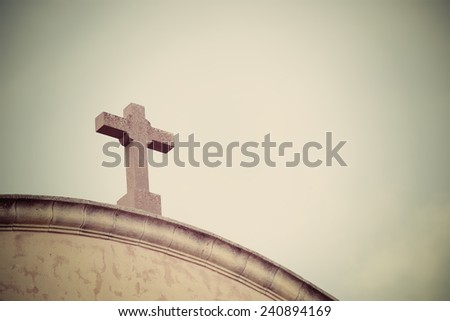 church cross in vintage tone effect - stock photo