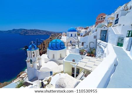 Church Cupolas of Oia town on Santorini island, Greece - stock photo
