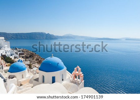 Church domes in Oia Santorini - stock photo