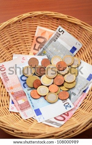 Church donations in a brown basket