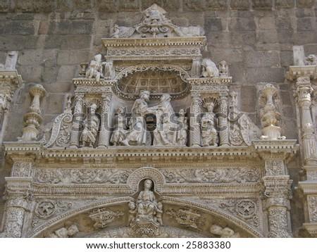 Church door sculpture, Toledo - stock photo