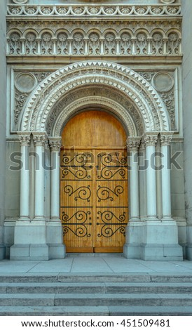 Church entrance with wooden door, front view - stock photo