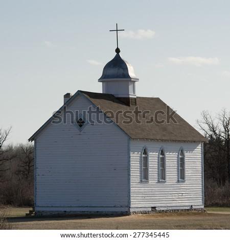 Church in a field, Manitoba, Canada - stock photo