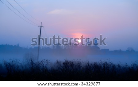 Church in a village at dawn - stock photo