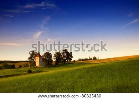 church in Czech country in green meadows - stock photo