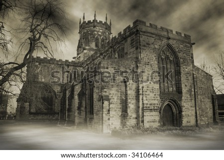 church in england. spooky gloomy place of worship with haze, fog and mist over graveyard