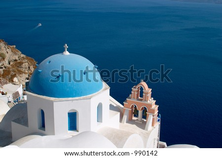 Church in Oia Santorini in front of the Mediterranian sea - stock photo