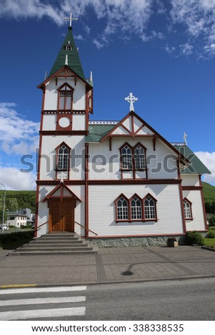 Church in the small town Husavik. Northern Iceland - stock photo