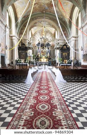 Church interior decorated before wedding ceremony - stock photo
