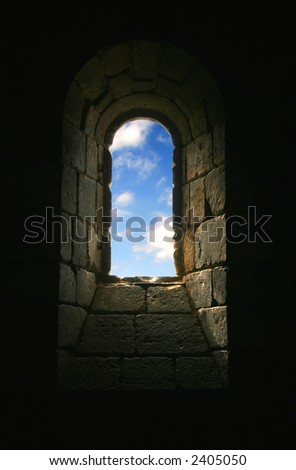 Church Keyhole with Blue Sky and Clouds in Window - stock photo