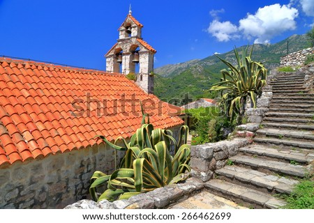 Church of an orthodox monastery surrounded by Mediterranean vegetation, Montenegro - stock photo