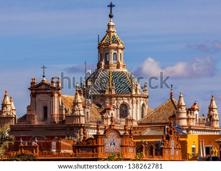 Church of El Salvador, Iglesia de El Salvador, Dome with Cross, Seville Andalusia Spain.  Built in the 1700s.  Second largest church in Seville. - stock photo