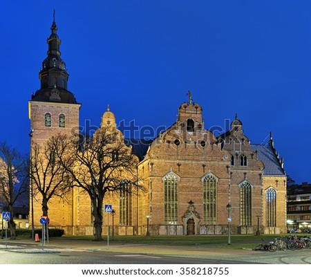 Church of Holy Trinity (Heliga Trefaldighetskyrkan) in Kristianstad at dusk, Sweden - stock photo