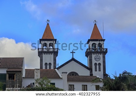 Church of Nossa Senhora da Alegria in Furnas with cloudy blue sky, Azores