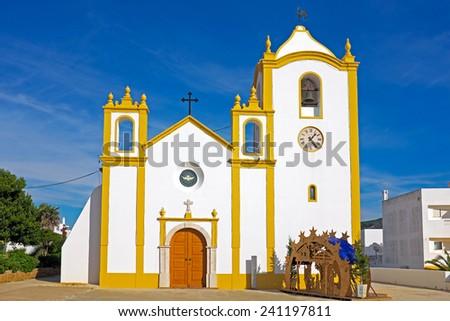 Church of Our Lady of the Light (Nossa Senhora da Luz) in Luz, Algarve, Portugal. - stock photo