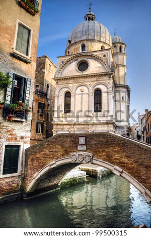 Church of Santa Maria dei Miracoli, in Venice, by a canal - stock photo