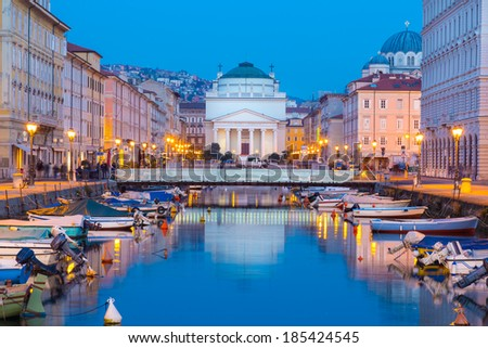 Church of St. Antonio Thaumaturgo is situated at northern end of Canale Grande. Its neo classical front facade and cupola represents one of emblems of Trieste, city and seaport in Italy, Europe. - stock photo