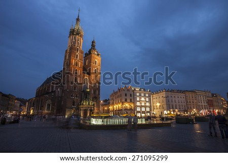 Church of St. Mary in Krakow Main Market Square during Twilight time - stock photo