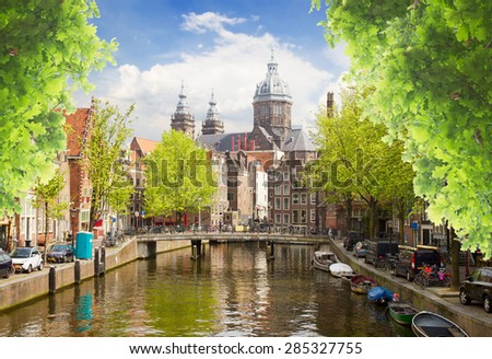 Church of St Nicholas, old town canal at summer day, Amsterdam, Holland - stock photo