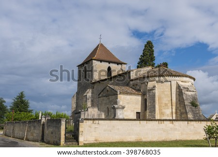 Church of Tayac and Francs  with blue sky and rain clouds.