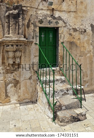 Church of the Holy Sepulchre (top entry) in Jerusalem, Israel - stock photo
