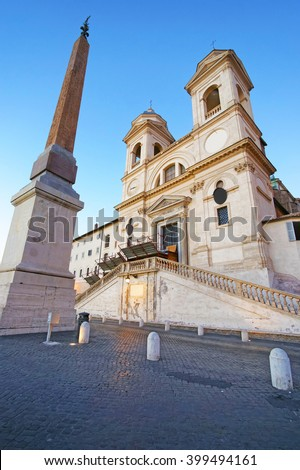 Church of Trinita dei Monti and Egyptian obelisk in Rome in Italy. It is a Roman Catholic and Renaissance church near the Spanish Steps leading to the Piazza di Spagna, that is the Square of Spain. - stock photo