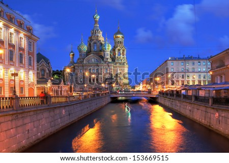 Church on Spilled Blood (or Resurrection Church of Our Savior) in Saint Petersburg, Russia on Griboedova Canal at twilight during the white nights of June. - stock photo