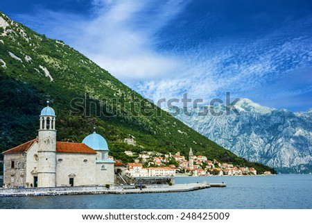 Church on the island in town Perast, Kotor bay, Montenegro.    - stock photo