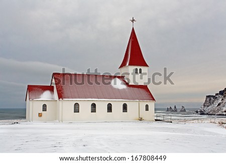Church on top of the mountain at Vik Iceland in wintertime - stock photo