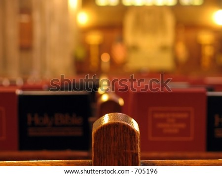 church pews with bibles - stock photo
