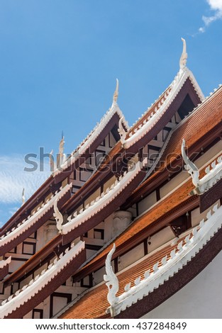 Church roof in the traditional Thai style of the Thai temple.(Public area not required Property Release) - stock photo