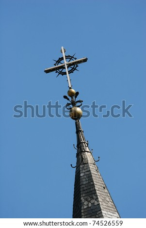 Church spire against the blue sky
