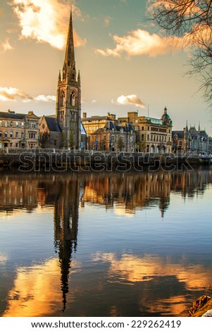 Church Steeple reflection on the River Tay - stock photo