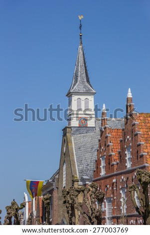 Church tower and facades in the historical center of Sloten, Holland - stock photo