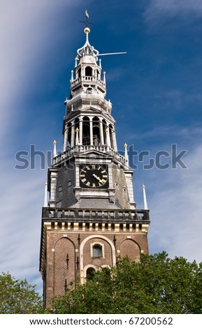 Church tower of Amsterdam´s oldest parish church - stock photo