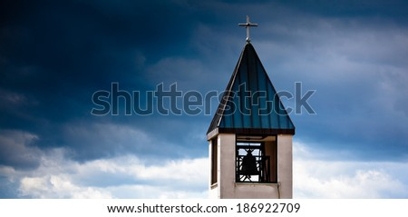 church tower with cloudy sky
