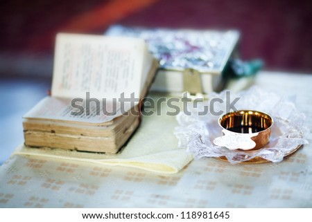 church utensil on an altar (soft focus, focus on cup with wine) - stock photo