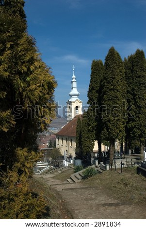 Church - view from a cemetery - stock photo