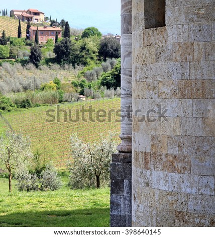 Church wall and landscape at the Abbey of Sant'Antimo (Abbazia di Sant'Antimo) near Montalcino, in Tuscany.